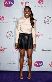 Sloane Stephens balanced out her menswear-inspired top with a girly black leather mini.