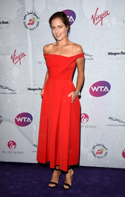 Ana Ivanovic looked breathtakingly elegant in this red off-the-shoulder dress by Preen during the WTA pre-Wimbledon party.