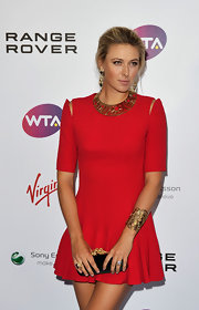 Maria completed her cherry red Alexander McQueen dress with a Tatjana Cuff in gold plated hardware.