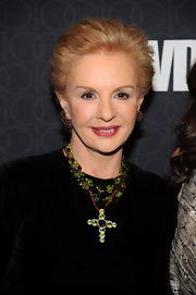 Carolina Herrera jazzed up her black outfit with a colorful cross pendant necklace at the WWD Anniversary gala.