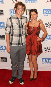 Angus T. Jones' gray slacks and plaid button-down at the SummerSlam kickoff party were a smart combination.