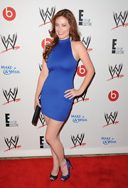 Melissa Archer's cobalt blue body-con dress made her fiery red hair pop.