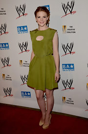 Green is definitely Ashley Bell's color! We loved this sweet cutout dress.