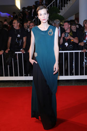 Sylvia Hoeks looked simply elegant in a two-tone column dress at the Venice Film Festival screening of 'Waiting for the Barbarians.'