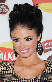 Chloe Sims wore her hair up in a mass of bobby-pinned curls at the launch of Walker's What's That Flavour.