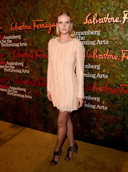 Anne V attended the Wallis Annenberg Center Inaugural Gala wearing a long-sleeve nude mini dress.