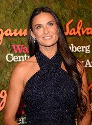 Demi Moore left her ultra-long hair loose with a center part and subtly wavy ends when she attended the Wallis Annenberg Center Inaugural Gala.