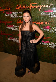 Monique Lhuillier chose an elegant sheer-overlay black strapless gown for the Wallis Annenberg Center Inaugural Gala.