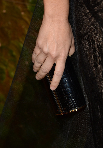 Monique Lhuillier went to the Wallis Annenberg Center Inaugural Gala carrying a stylish black crocodile tube clutch.