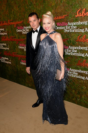 Gwen Stefani cleverly disguised her baby bump in a fringed blue Ferragamo halter gown during the Wallis Annenberg Center Inaugural Gala.