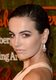 Camilla Belle glammed up her look with colorful chandelier earrings by Van Cleef & Arpels.
