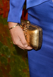 Victoria Hervey's metallic gold snakeskin clutch provided a striking contrast to her blue outfit at the Wallis Annenberg Center Inaugural Gala.