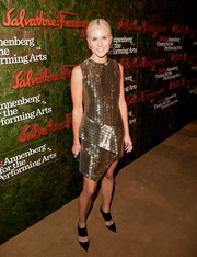 Olympia Scarry looked ultra modern at the Wallis Annenberg Center Inaugural Gala in a beaded gold Ferragamo dress with folded detailing and an asymmetrical hem.