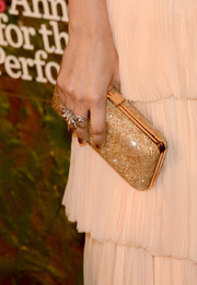 Camilla Belle added sparkle to her look with a bedazzled gold hard-case clutch when she attended the Wallis Annenberg Center Inaugural Gala.