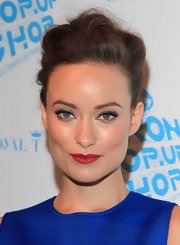 Olivia Wilde paired her classic red lipstick with a loose french twist that was all to elegant.