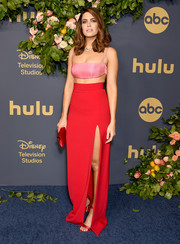 Mandy Moore teamed her top with a high-slit red maxi skirt, also by Brandon Maxwell.
