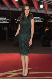 Sarah Kazemy chose a green and black lace-overlay sheath for the 'Waltz with Monica photocall.