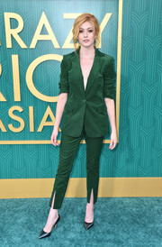 Katherine McNamara was elegantly suited up in this green velvet jacket and pants combo by Frame at the premiere of 'Crazy Rich Asians.'