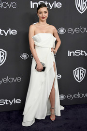 Miranda Kerr flashed lots of skin in a high-slit, strapless white gown by August Getty Atelier at the Warner Bros. and InStyle Golden Globes post-party.