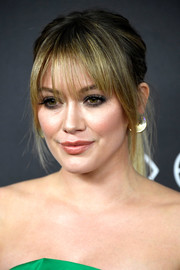 Hilary Duff looked edgy-chic with her ponytail and wispy bangs at the Warner Bros. and InStyle Golden Globes post-party.