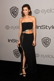 Nina Dobrev teamed her dress with black satin sandals by Jimmy Choo.