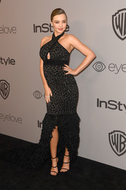 Miranda Kerr sealed off her look with strappy black sandals by Giuseppe Zanotti.