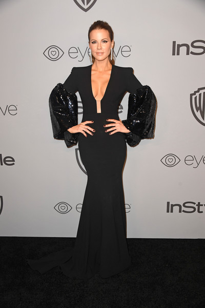 Kate Beckinsale showed off her curves in a black Alex Perry fishtail gown with a plunging neckline and shiny bell sleeves at the Warner Bros. and InStyle Golden Globes after-party.