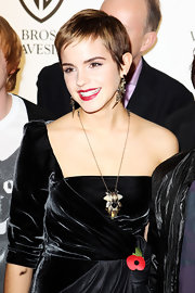Emma Watson attended a photocall wearing a chunky Erickson Beamon pendant necklace with a one-shoulder LBD.