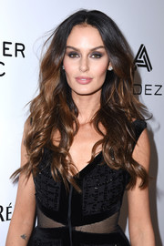 Nicole Trunfio sported glamorous center-parted waves at the Warner Music Group Grammy party.