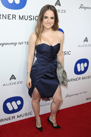 Jojo looked tres chic in a structured navy strapless dress while attending the Warner Music Group Grammy celebration.