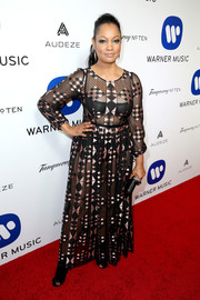Garcelle Beauvais was boho-sexy in a sheer, geometric-patterned maxi dress at the Warner Music Group Grammy celebration.