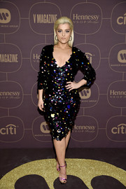 Bebe Rexha rounded out her party look with a pair of metallic purple sandals.