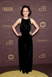 Lena Hall donned a dark green velvet jumpsuit for the Warner Music Group pre-Grammy celebration.