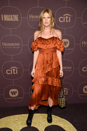 Alexandra Richards was a boho babe in this burnt-orange cold-shoulder halter dress at the Warner Music Group pre-Grammy celebration.