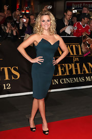 Reese showed off her figure in a green strapless cocktail dress with a dramatic sweetheart neckline for the Sydney premiere of 'Water for Elephants.'