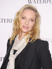 Uma Thurman wore her casually tousled locks with a deep side part and soft waves at the Waterford unveiling of Live a Crystal Life.