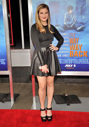 Zoe Levin opted for a long-sleeve black dress with a flouncy leather skirt and leather detailing  on the sleeves for her red carpet look.