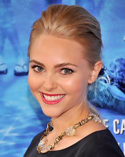 A pretty pink lip complemented AnnaSophia's bold clutch perfectly.