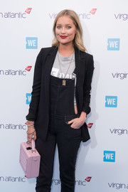 Laura Whitmore teamed her outfit with some colorful beaded bracelets.