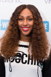 Alexandra Burke framed her face with thick, tight curls for WE Day UK.