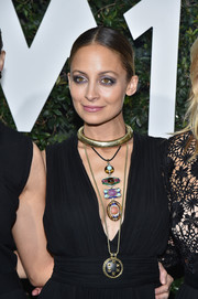 Nicole Richie adorned her decollete dress with layers of bling, including a colorful totem necklace by David Webb.