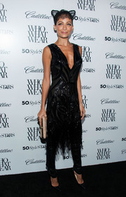 Nicole Richie sported a flapper-girl-meets-Catwoman get-up with this beaded, fringed LBD and headdress combo at the Who What Wear event.
