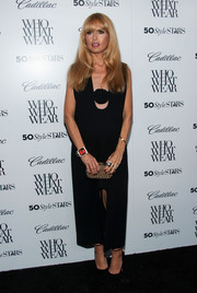 Rachel Zoe cleverly hid her baby bump in a little black dress with a unique neckline and a front slit during the Who What Wear event.