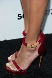 Ashley Madekwe stepped out on the Who What Wear black carpet in super-stylish red platform sandals by Nicholas Kirkwood.