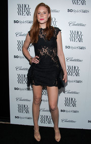 Christiane Seidel put lots of skin on display in a super-short lace LBD with see-through panels during the Who What Wear event.