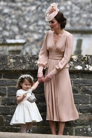 Kate Middleton kept it modest and classy in a long-sleeve nude cocktail dress by Alexander McQueen during her sister Pippa's wedding.
