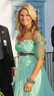 Princess Madeleine showed off her silver bracelet while hitting the wedding of Prince Nikolaos.