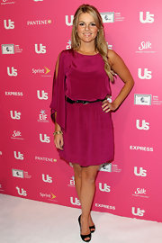 Ali donned a brilliant fuchsia dress with a little belt and one long draped sleeve.
