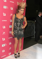 Kesha wears a beaded and fringed silver cocktail dress to go with this edgy red carpet style.