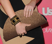 Sara Rue paired her sparking clutch with a black-and-gold gemstone bracelet.